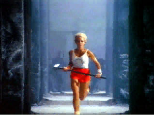 "Scene from Apple's ""1984"" Super Bowl advertisement: athletic blonde woman runs with sledgehammer."