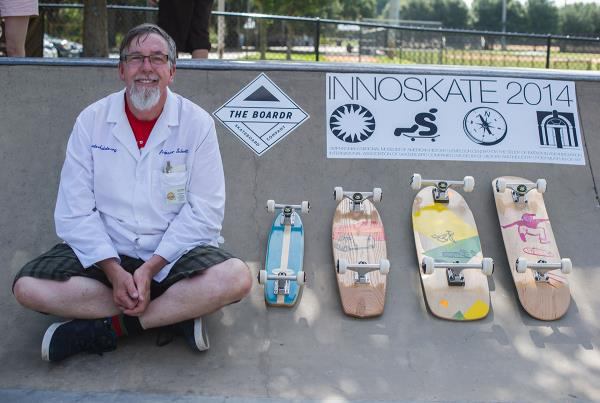 Professor Paul Schmitt with his replica boards representing different eras.