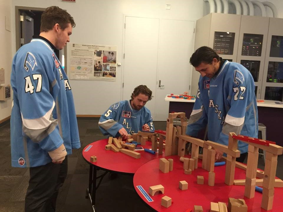 Members of the Alaska Aces hockey team build a soundscape during Spark!Nite, a Spark!Lab event for adults; photo courtesy of the Anchorage Museum