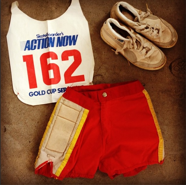 Competition bib, sneakers, and shorts donated to the national collections by Cindy Whitehead.