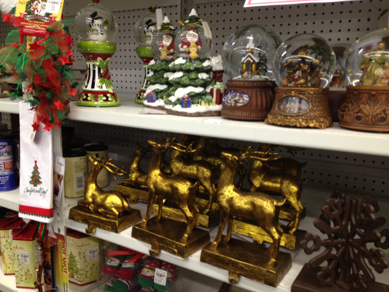 store shelf crowded with Christmas decorations