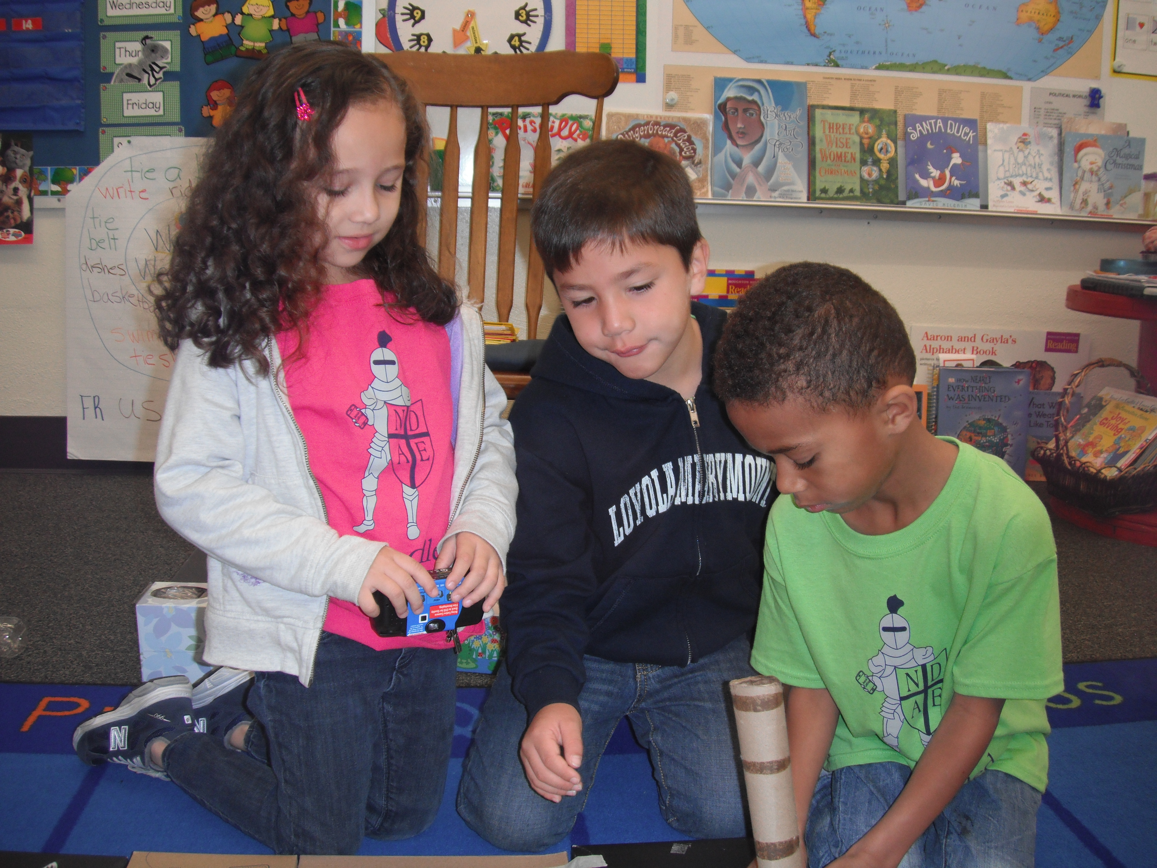 Kindergarteners inventing with recycled materials