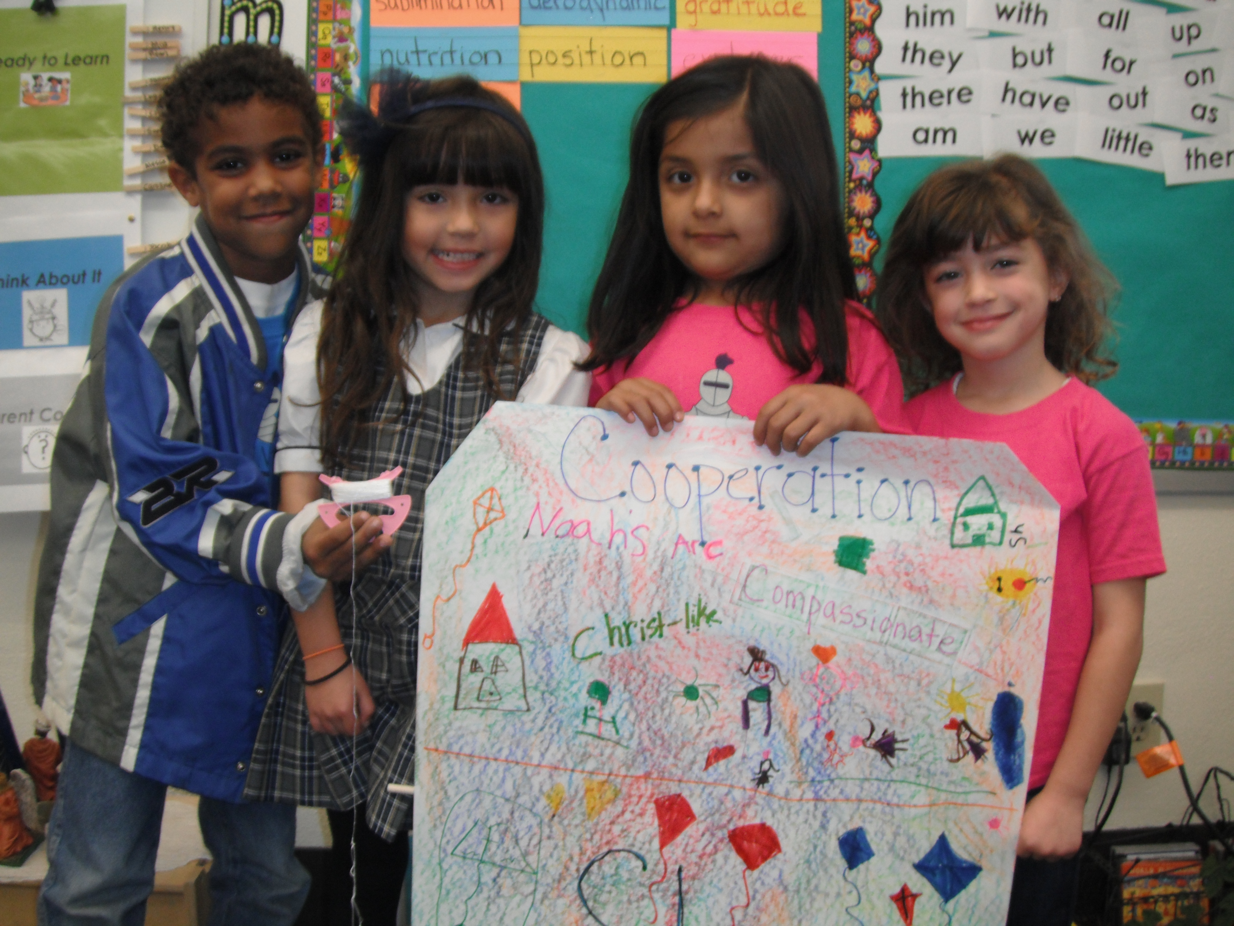 Young students display their invention idea