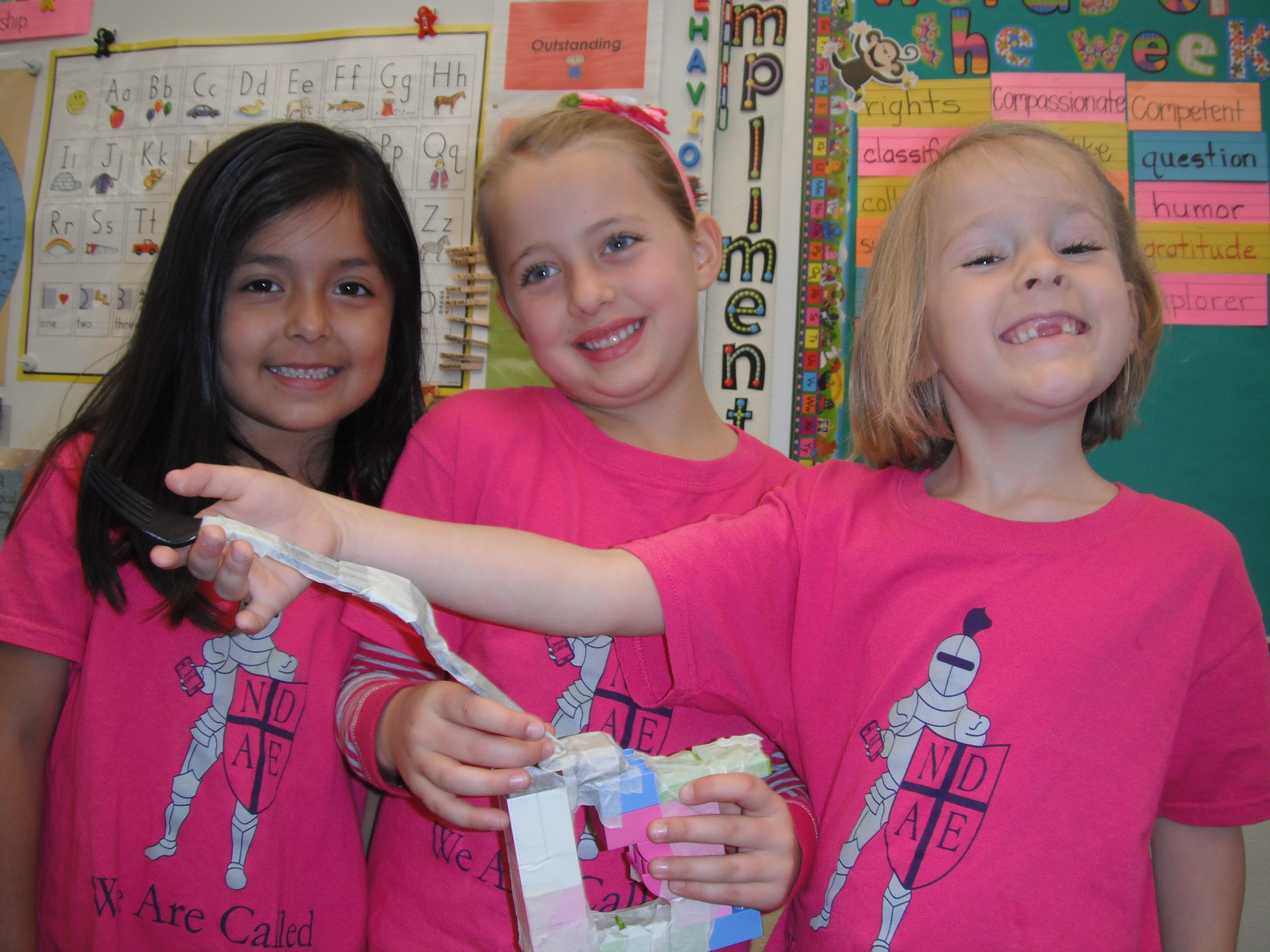 Young girls display their invention idea