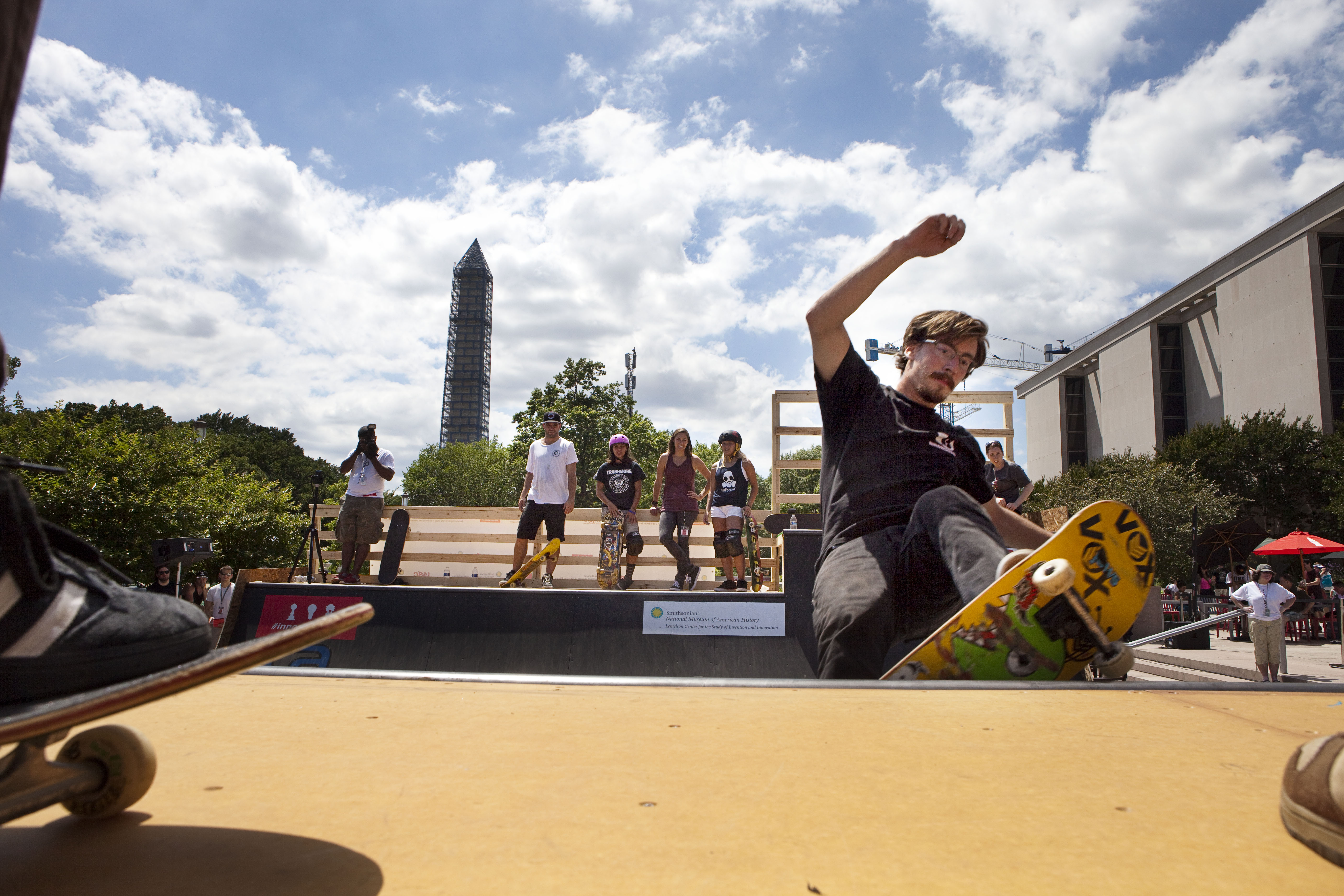 Shaun Gregoire rides the mini ramp in front of the Washington Monument and the National Museum of American History.
