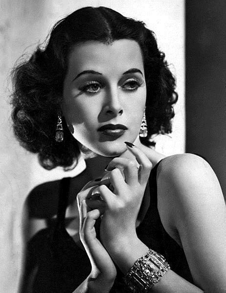 Black and white photo of actress/inventor Hedy Lamarr with dark manicure.