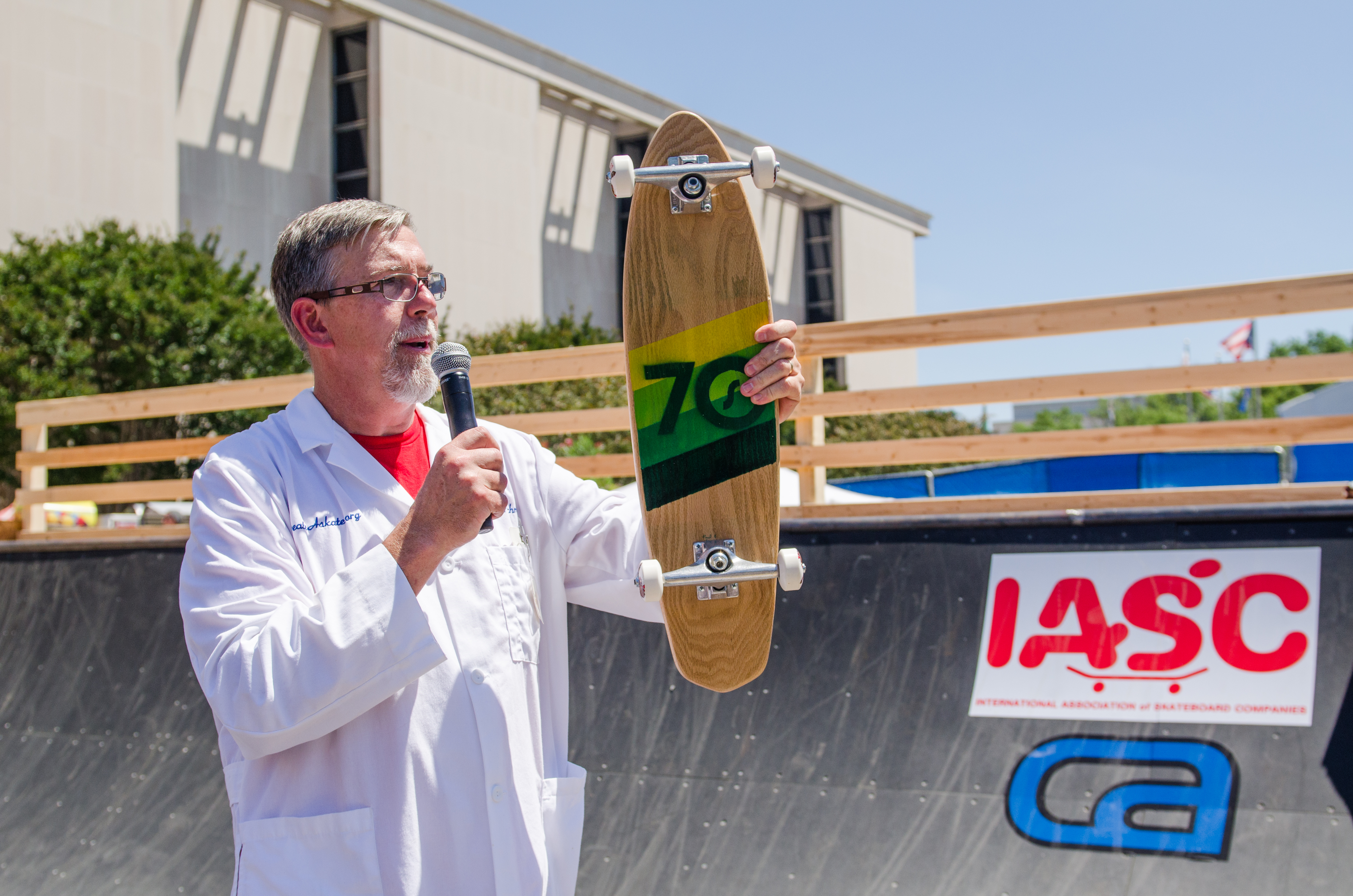 """""""Professor"""" Paul Schmitt discusses the evolution of skateboards, here showing off a deck representing the typical 1970s era technology."""