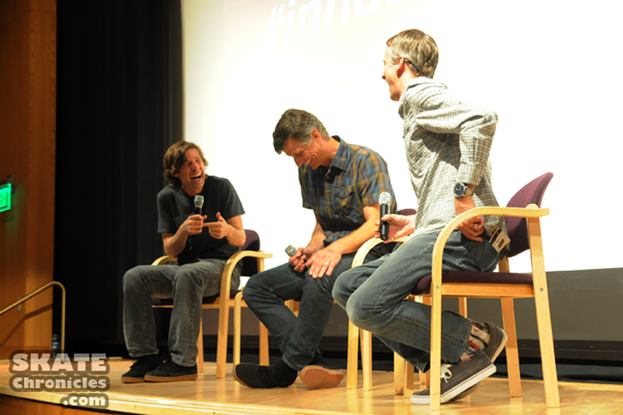 "Rodney Mullen, Miki Vuckovich, and Tony Hawk share a laugh on stage following a screening of ""Bones Brigade: An Autobiography."""