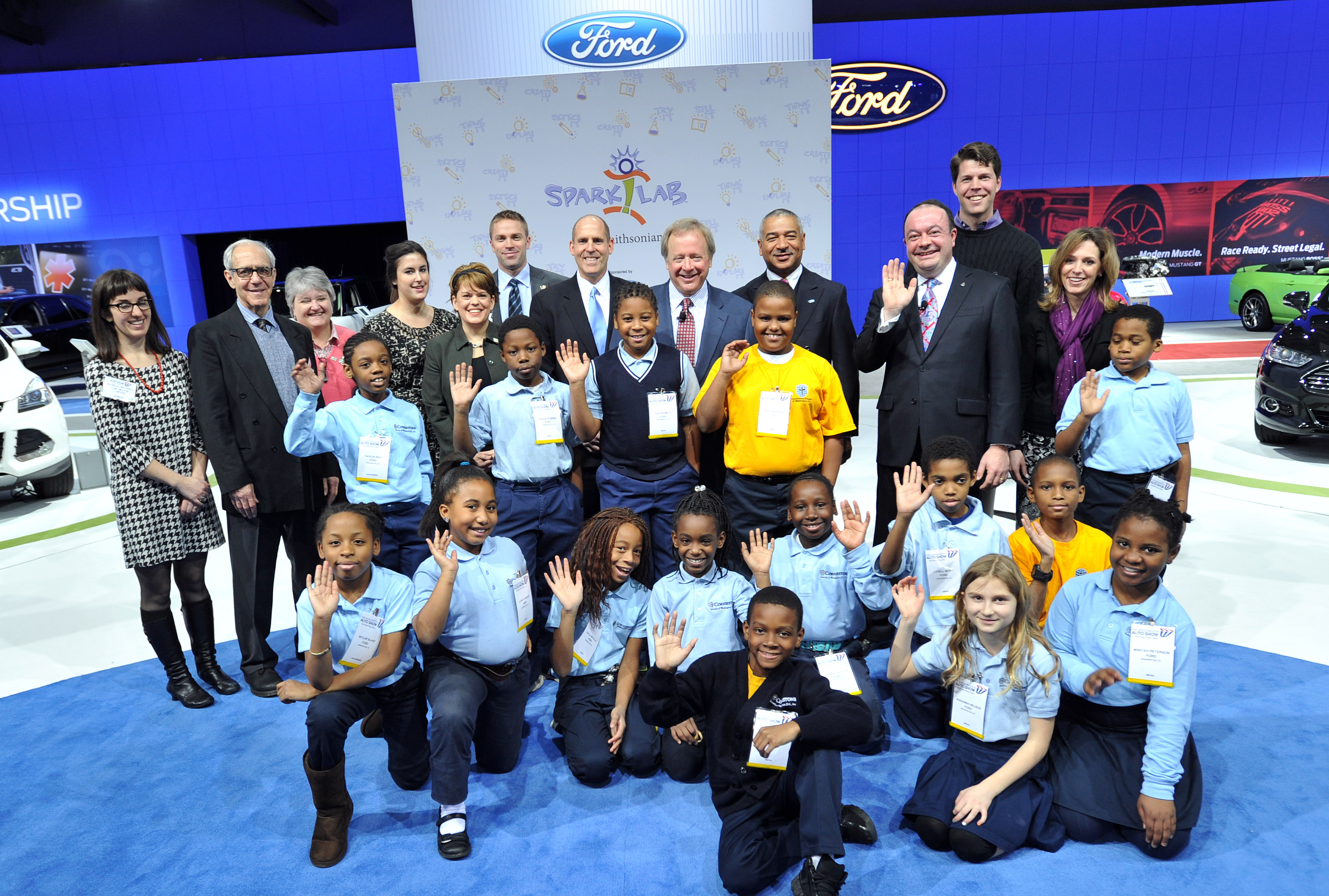 Ford executives with representatives of the Smithsonian, and fourth grade students from Cornerstone Schools of Washington D.C.