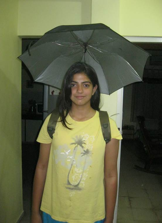 A young girl wears her invention, a wearable umbrella