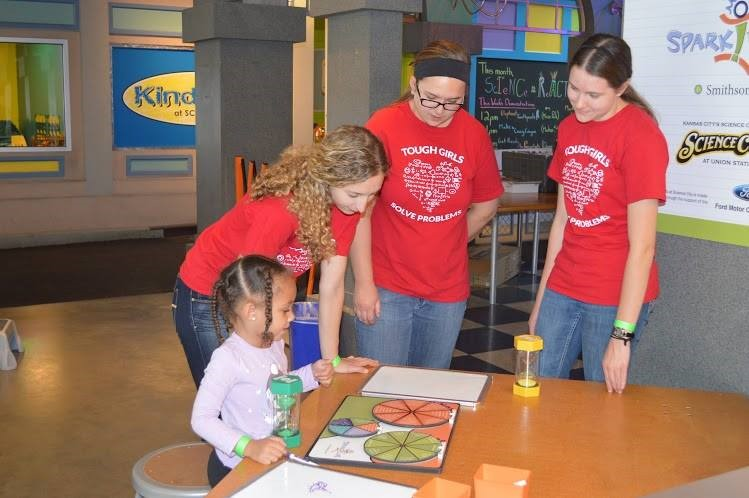 Members of the Tough Girls, a robotics club at a local high school, facilitated activities in Spark!Lab; photo courtesy of Science City at Union Station