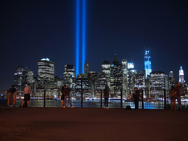 Two blue beams of light stream into the heavens from the site of Ground Zero.
