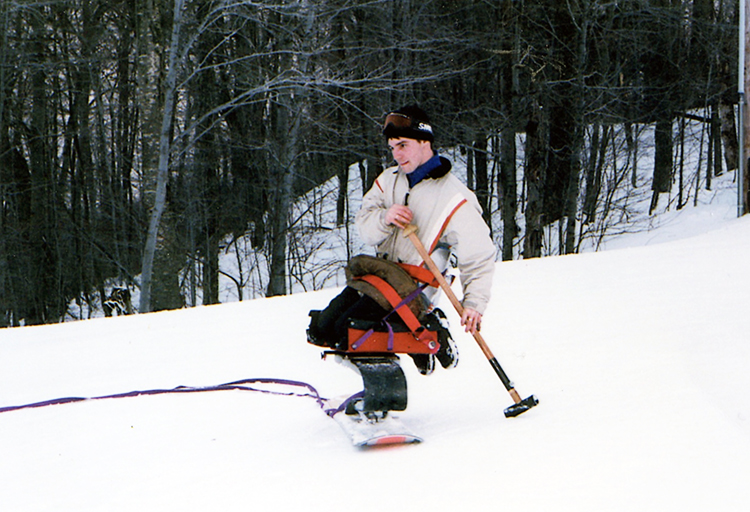 Testing an early prototype of an accessible snowboard, late 1990s