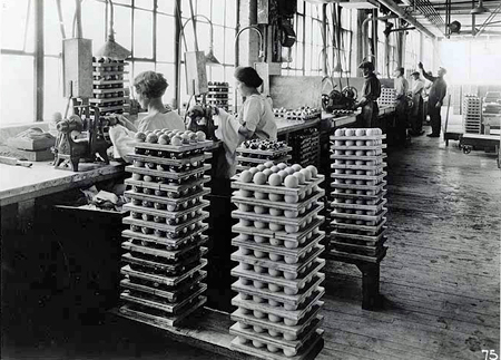 Women workers using polishing lathes during Celluloid billiard ball manufacturing
