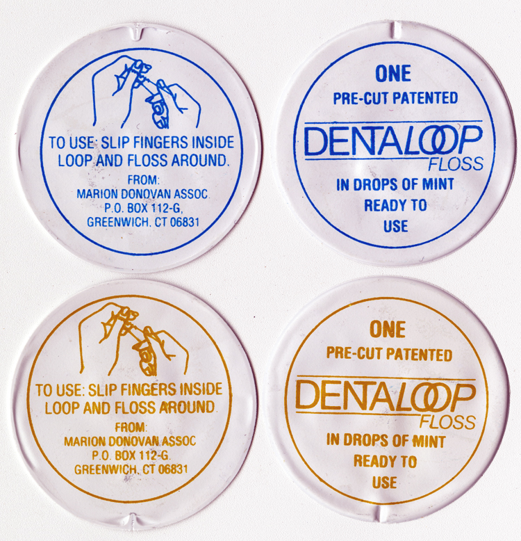 """4 foil packets of DentaLoop floss, 2 with blue printing and 2 with orange-brown printing. Each packet reads """"One pre-cut patented DentaLoop floss in drops of mint ready to yse"""" on one side and """"To use: slip fingers inside loop and floss around. From Marion Donovan Assoc. P.O. Box 112-G, Greenwich, CT 06831"""" on the reverse side."""