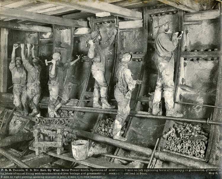Six men working inside the tunnel