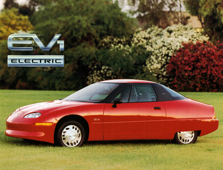 EV1 product card showing a red car parked on a wide lawn, 1996