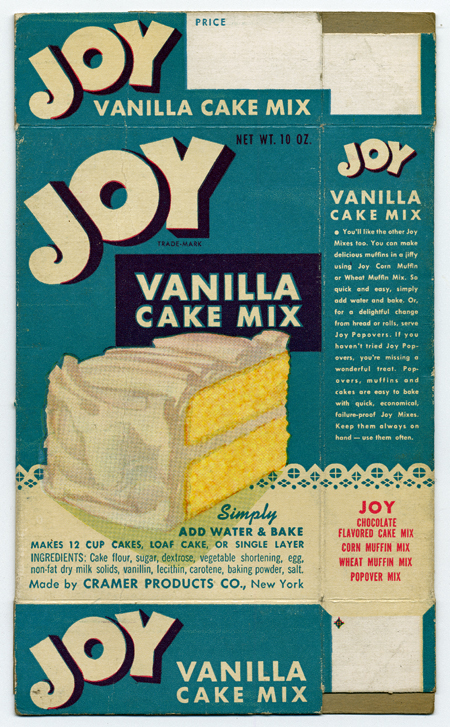 """Illustrated cake mix box, with an aqua background and an drawing of a slice of yellow cake with white frosting. Wording on the box includes """"Joy Vanilla Cake Mix. Simply add water & bake. Makes 12 cup cakes, loaf cake, or single layer. .Ingredients: Cake flour, sugar, dextrose, vegetable shortening, egg, non-fat dry milk solids, vanillin, lecithin, carotene, baking powder, salt. Made by Cramer Products Co., New York."""""""
