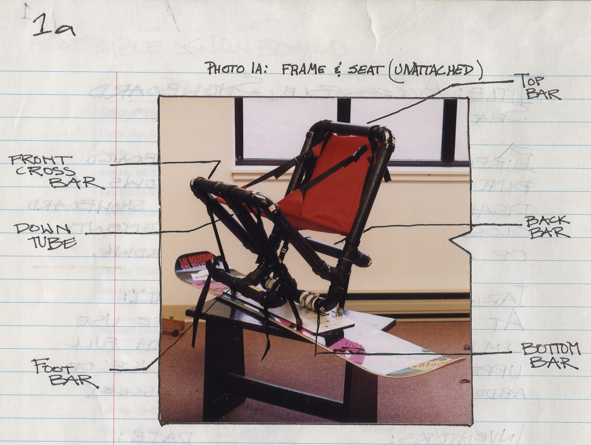 An annotated image of a prototype of the accessible snowboard, pasted into the invention notebook of Capozzi and Connolly