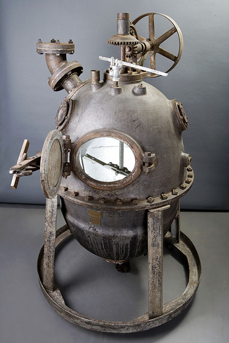 Egg-shaped metal apparatus that looks something like an old-fashioned diver's helmet