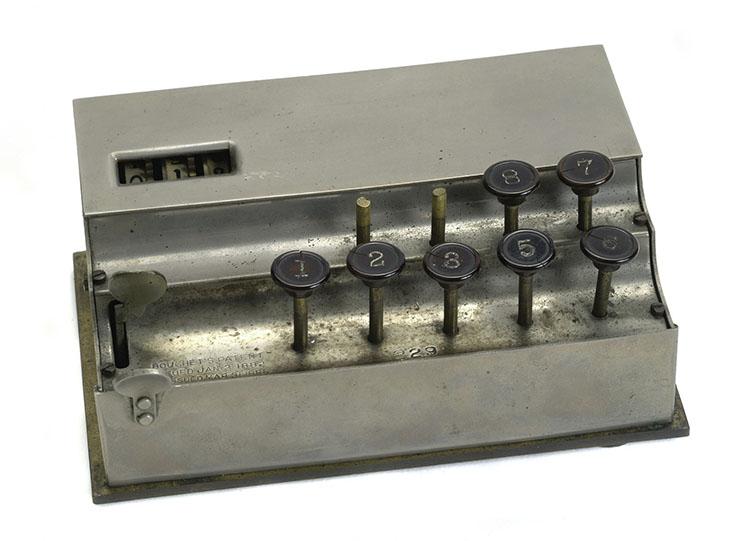 Small metal adding machine with 9 keys