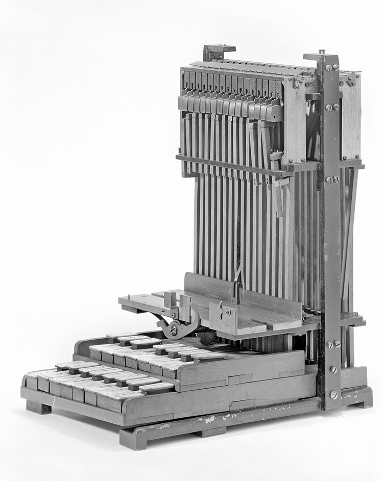 L-shaped model with piano-like keys at the bottom