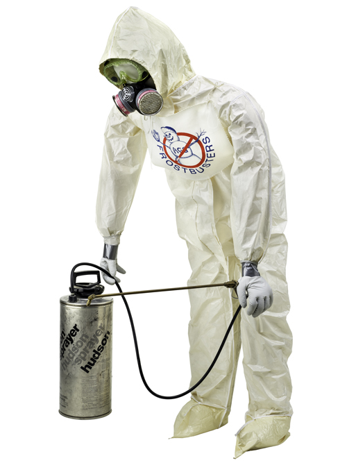Mannequin wearing a protective jumpsuit and holding a spray canister, both used in the first release of GMOs into the environment in 1987