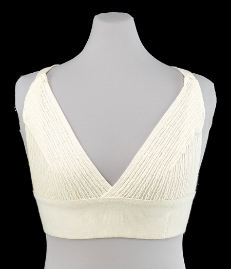 Prototype of the original Jogbra on a half-torso mannequin. The prototype was made from two desconstructed men's athletic supporters that were then sewn together onto a wide elastic band, with two narrow pieces of stockinette straps sewn onto the elastic band and the athletic supporters.