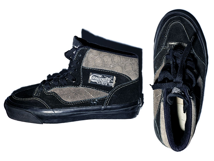 Vans black and grey suede hi-top skateboarding shoes with a black suede toe and eyestay, black midsoles, and the trademark deep tan, waffle pattern soles.