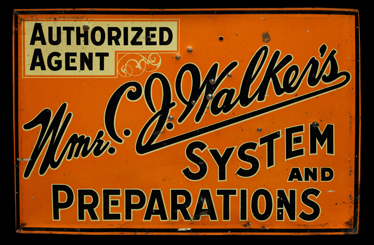 "An orange metal sign with black lettering, reading ""Authorized Agent (highlighted in yellow). Mme. C. J. Walker's System and Preparations."" Mme. C. J. Walker's is written in cursive across the diagonal of the sign, from lower left to upper right. The other words are written in block letters."