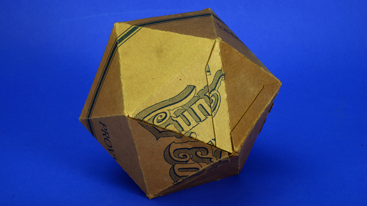Cardboard geometric model with 20 sides.