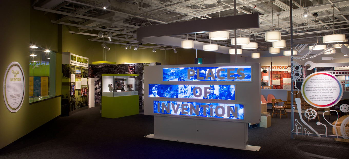 Entry way into Places of Invention exhibition with lit-up title sign
