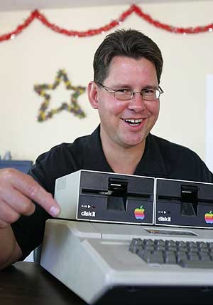 Rich Skrenta poses in front of his first personal computer, the Apple II Plus