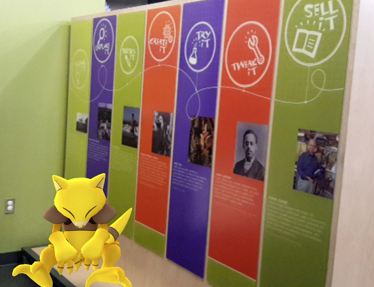 Abra, a Psychic-type Pokémon, sitting near the entrance to Spark!Lab