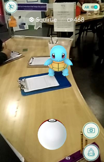 A Squirtle Tiny Turtle Pokémon sitting on a blue clipboard