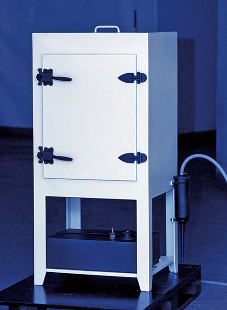 Model is a white cube on legs with a hinged door and controls on the base