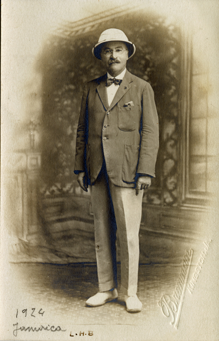 Formal full-length portrait of inventor Leo Bekeland wearing a suit and pith helmet
