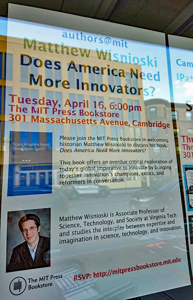 Poster for Matt Wisnioski's book talk at the MIT Press bookstore, photographed through the store window