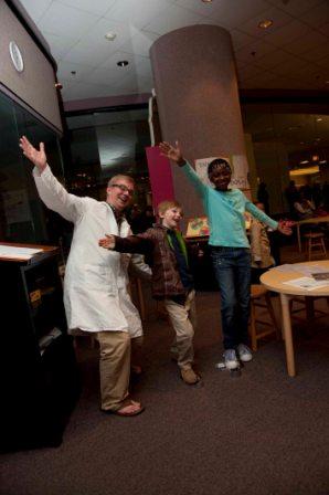Steve Madewell celebrating with visitors inside the original Spark!Lab.