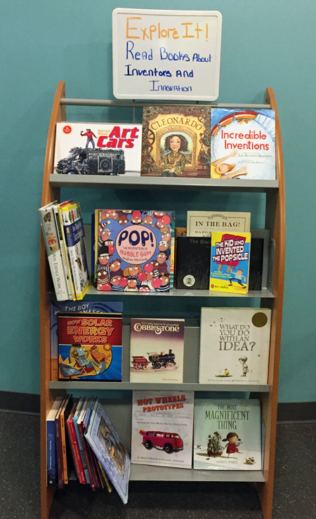 Shelves of kids' books about invention