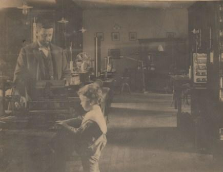 Elmer Gates in his lab with young boy using sorting box, undated.