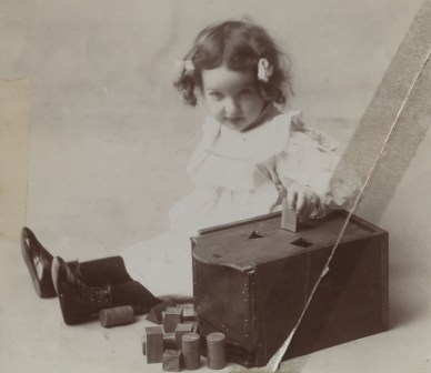 Elmer Gates's daughter Phoebe demonstrating sorting box.