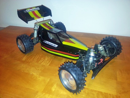 Schumacher CAT (Competition All Terrain) XLS RC car, late 1980s, shown in three-quarters profile view  from the front