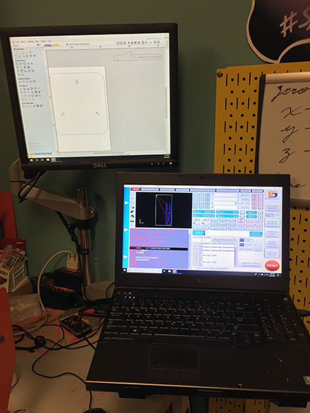 A laptop and computer monitor showing design tools