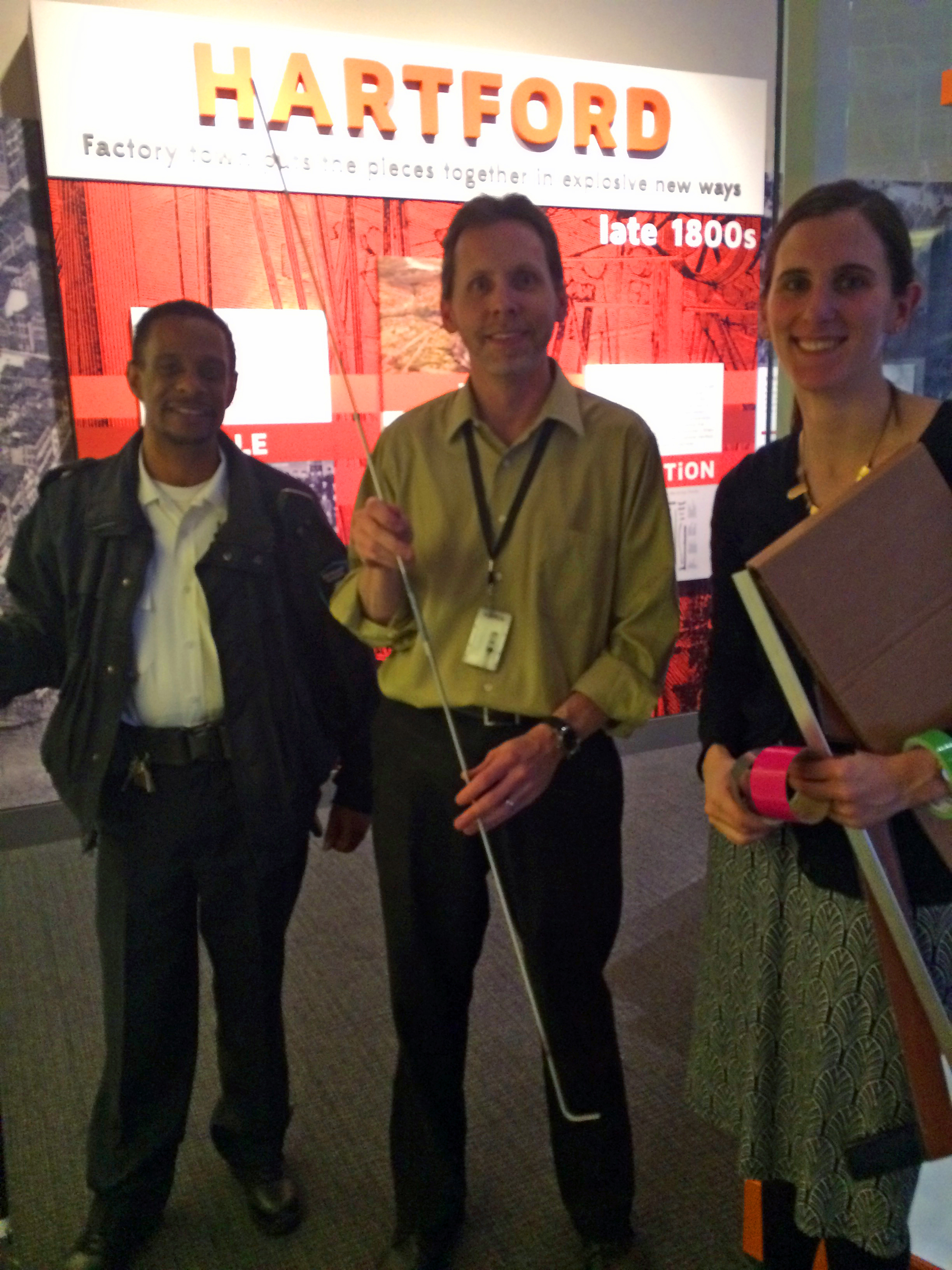 National Museum of American History staff members Sergeant Patrick Newman, Tim Pula, and Jocelyn Knauf