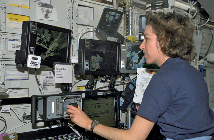 Astronaut Ellen Ochoa controlling the space shuttle robotic arm, 11 April 2002