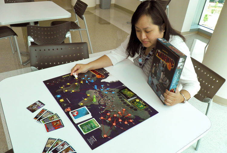 A young woman playing Pandemic