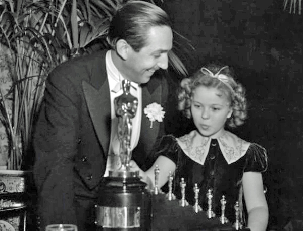 Walt Disney receiving Oscar from Shirley Temple, 1939
