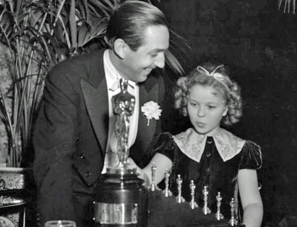 Walt Disney receiving Oscar from Shirley Temple, 1939