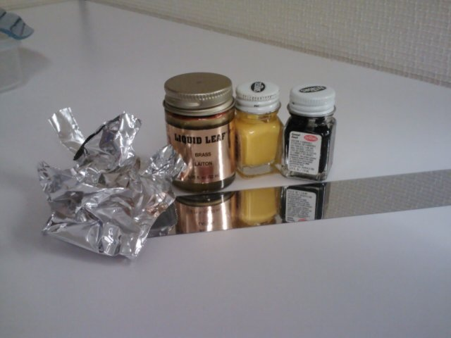 materials found around the office: model toy paint, aluminum foil, cake sprinkles, and clay.